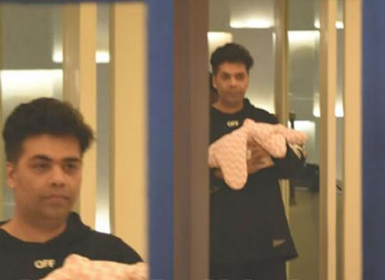 Karan Johar arrives home carrying baby Roohi in his arms!