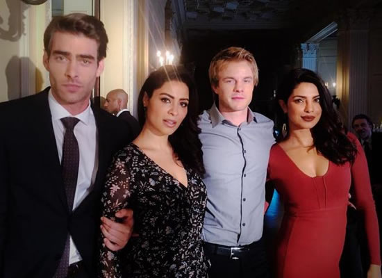 Priyanka Chopra looks red hot as she poses with her Quantico starcast!
